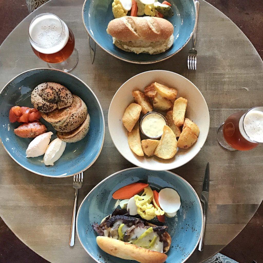 Fab Review: Brunch at Band of Bohemia // Fried Chicken Breast, Fried Kennebecs, Brisket Cheese Steak, and Knot Bagel // Photo: @topchicagoeats