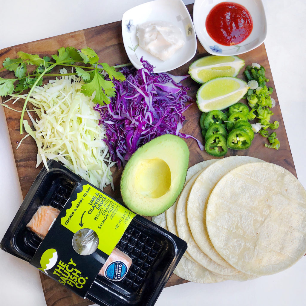 Fab Recipe: Easy Salmon Fish Tacos with Spicy Slaw // The Saucy Fish Co // Photo: @fabsoopark